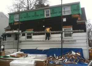 ripping or tearing off old siding from house by nj contractors